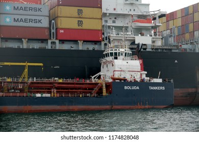 ALGECIRAS, SPAIN – AUGUST 25. Container ship MSC JUDITH working with containers handling gantry cranes and taking fuel from little tanker in the port of Algeciras, on august 25, 2018 in Cadiz.