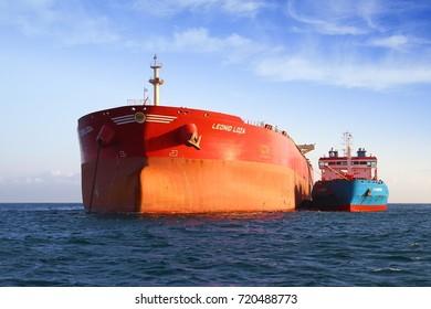 ALGECIRAS, SPAIN – AUGUST  29: Petrol tanker LEONID LOZA  anchored in Algeciras Bay join to supplies vessel CT LONGFORD Gibraltar Rock, on august 29, 2017 in Cadiz.