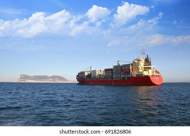 ALGECIRAS, SPAIN – JULY 25. The container ship MAX CARRIER waits anchored close to the port of Algeciras for download containers on harbors quay, on july 25, 2017 in Cadiz.