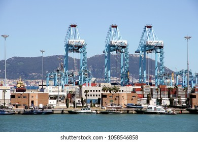 ALGECIRAS, SPAIN - MARCH 16, 2018: Containers pier in the port of Algeciras with lots of handling gantry cranes downloading containerships in Algeciras harbor on march 16, in Cadiz.