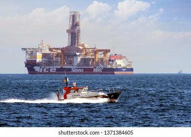 ALGECIRAS, SPAIN - MARCH 23, 2019. Pilot cutter of Algeciras harbor sailing close to drillship Stena Icemax in Algeciras bay.