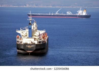 ALGECIRAS, SPAIN – OCTOBER 23, 2018. Liquid Propane Gas and tamker ships anchored close to the port of Algeciras and the rock of Gibraltar, in Cadiz.