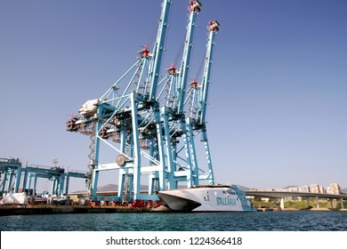 ALGECIRAS, SPAIN - SEPTEMBER 04, 2018: The fast ferry JAUME III of BALEARIA LINES waiting passengers down high cranes of APM Terminal in Algeciras harbor in Cadiz.