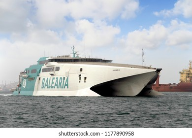 ALGECIRAS, SPAIN - SEPTEMBER 04: The fast ferry JAUME III of BALEARIA LINES with his passengers entering in Algeciras harbor; on September 04, 2018 in Spain.