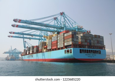 ALGECIRAS, SPAIN – SEPTEMBER 18, 2018. Great container ship MAERSK DENVER working with 4 containers handling gantry cranes in the ATM Terminal in the port of Algeciras.
