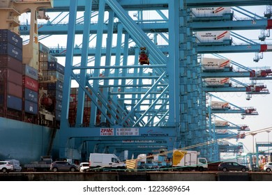 ALGECIRAS, SPAIN – SEPTEMBER 18, 2018. Details viewed from land of various containers handling gantry cranes working simultaneously in the ATM Terminal in the port of Algeciras.