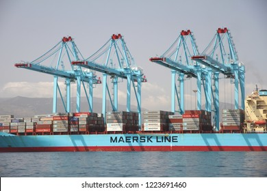 ALGECIRAS, SPAIN – SEPTEMBER 18, 2018. Port side of a great container ship working with 4 containers handling gantry cranes in the ATM Terminal in the port of Algeciras.
