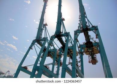 ALGECIRAS, SPAIN – SEPTEMBER 18, 2018. Big blue handling gantry cranes in the ATM Terminal in the port of Algeciras in Cadiz.
