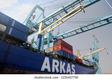 ALGECIRAS, SPAIN – SEPTEMBER 18, 2018. Great container ship TEOMAN ARKAS working with containers handling gantry cranes in the ATM Terminal in the port of Algeciras in Cadiz.