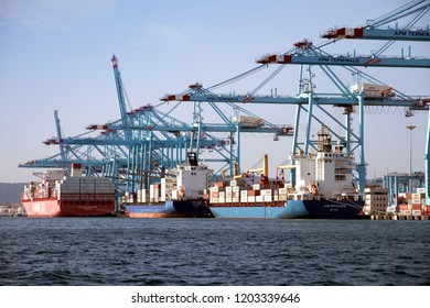 ALGECIRAS, SPAIN – SEPTEMBER 25. Group of containers vessels working by means of handling gantry cranes in the port of Algeciras, on september 25, 2018 in Cadiz.