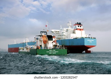ALGECIRAS, SPAIN – SEPTEMBER  29: Big Petrol tanker ADVANTAGE SPRING anchored in Algeciras Bay join to supplies vessel BAHIA UNO close to Gibraltar Rock, on september 29, 2018 in Cadiz.