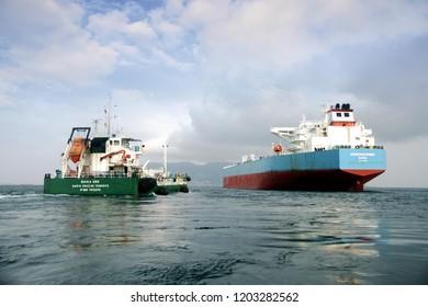 ALGECIRAS, SPAIN – SEPTEMBER  29: Big Petrol tanker ADVANTAGE SPRING anchored in Algeciras Bay join to supplies vessel BAHIA UNO close to Gibraltar Rock, on september 29, 2018 in Cadiz.