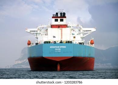 ALGECIRAS, SPAIN – SEPTEMBER  29: Big Petrol tanker ADVANTAGE SPRING anchored in Algeciras Bay close to Gibraltar Rock, on september 29, 2018 in Cadiz.