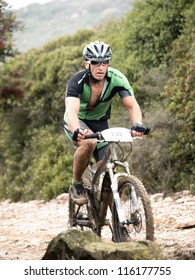 ALGECIRAS, SPAIN - SEPTEMBER 30: VIII MARATON ALCORNOCALES - ESTRECHO on September 30, 2012 in Algeciras, Spain.68 km Mountain bike marathon in the mountains Rider: TOCON GOMEZ, JUAN MANUEL