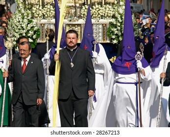 ALGECIRIAS, SPAIN - APRIL 4: Bearers at Palm Sunday Procession in Algeciras,  April 4, 2009. The conical hoods evokes an approach of the bearer to the sky, interpreted like salvation place.