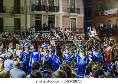 """Algemesi, Valencia/Spain""; September 7 2019: The women group of bastonets do the traditional dance clashing the iron plates during the night parade at the La Mare de Deu de la salut festival."