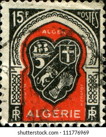 ALGERIA - CIRCA 1947: A  stamp printed in Algeria shows coat of arms, circa 1947