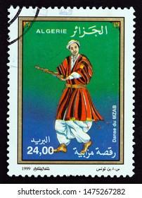 "ALGERIA - CIRCA 1999: A stamp printed in Algeria from the ""Folk Dances"" issue shows Danse M'zab, circa 1999."