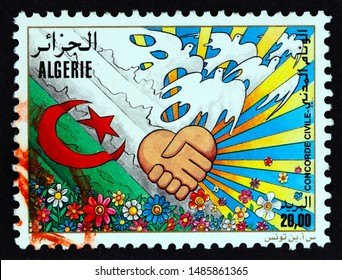 "ALGERIA - CIRCA 2000: A stamp printed in Algeria from the ""Civil Concord"" issue shows doves, flowers, handshake, circa 2000."