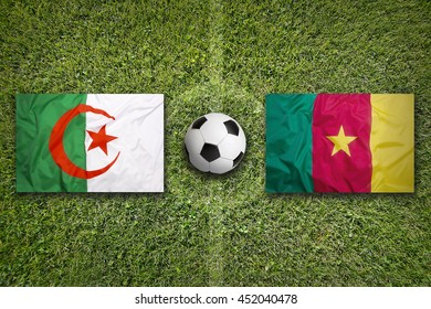 Algeria vs. Cameroon flags on green soccer field
