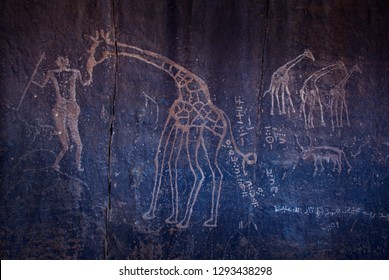 Algeria, Wilaya Tamanrasset, Hoggar Mountains, ancient rock drawings of animals in the Sahara desert