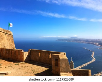 Algerian flag and Mediterranean Sea in Fort Santa Cruz, Oran, Algeria.