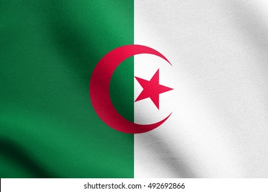 Algerian national official flag. African patriotic symbol, banner, element, background. Flag of Algeria waving in the wind with detailed fabric texture