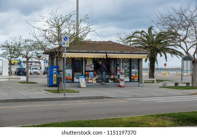 Alghere,Italy,12-April-2018:Man is looking in a street kisok shop for souvenir, paper or magazine in Alghero,Alghero is a big city in the west of the italian island of Alghero and also the airport