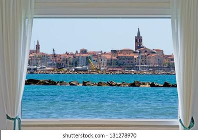 alghero by the sea seen from a window