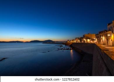 Alghero harbor at night. Italy