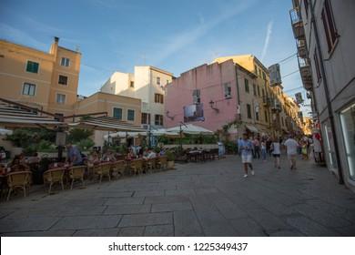 Alghero, Italy - 20 September 2018: Street in the center of the old city of Alghero