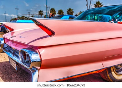 Alghero, Italy - April 08, 2018: Classic pink Cadillac at American Motor Festival 2018