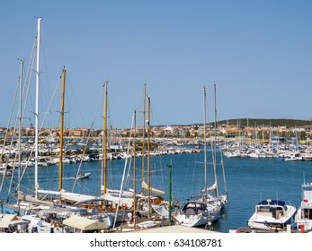ALGHERO, ITALY - JULY 21, 2016 - Summer view of the port of Alghero on a beautiful sunny day.