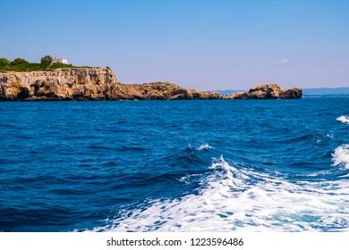 Alghero, Sardegna, Italy - Rocky islands and limestone cliffs of the Capo Caccia cape at the Gulf of Alghero