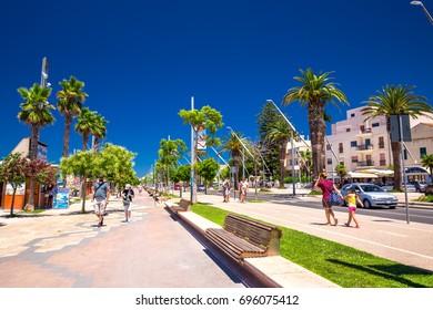 ALGHERO, SARDINIA - August 2017 - Alghero old city center with olive tree and colorful houses, Alghero, Sardinia, Italy, Europe.