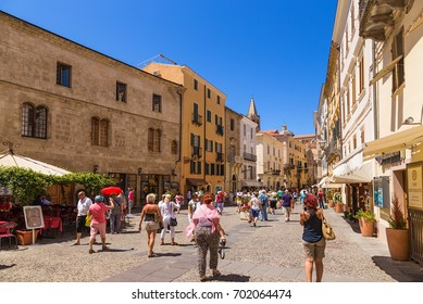 ALGHERO, SARDINIA, ITALY - JUL 07, 2016: Tourists on the street in the old town
