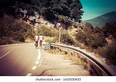 Alghero, Sardinia / Italy - May 22 2019: couple on bicycles in a country road