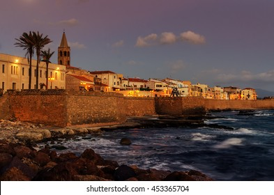 Alghero, Sardinia, Italy: skyline with defensive walls in the beautiful sunset of Mediterranean summer