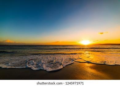 Alghero shore under a clear sky at sunset. Sardinia, Italy
