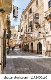Alghero,Italy,13-april-2018:people walking in the old streets of alghero on sardinia island,alghero is the biggest city on the west part of the italian island