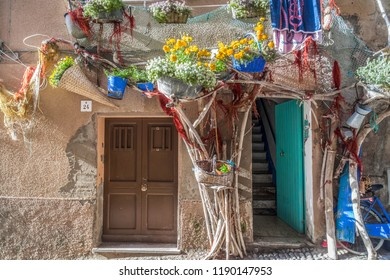 ALGHERO,ITALY-APRIL 9,2013:Decorated facade house in Alghero, Sardinia, Italy.