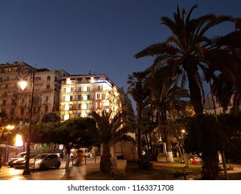 Algiers,  Algeria- 2016-2018. Night view of the lights in city center with French style buildings and palm trees