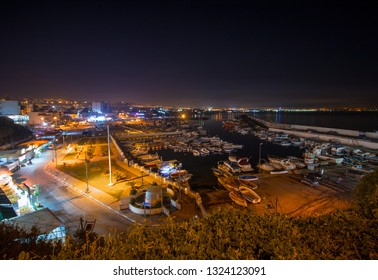 Algiers , Algeria - February 22, 2019 : Colorful fishing boats at the night in the port of ain benian , El Djamila