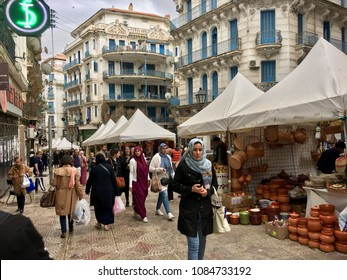ALGIERS, ALGERIA - MAY 5, 2018: Open air souk at Didouche Mourad Street locating in French colonial side of the city of Algiers, Algeria.Modern city has many old French type buildings and passages.