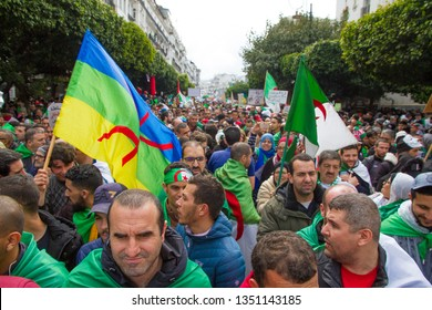 Algiers, Algeroa - March 22 2019 : 5th Friday of peaceful popular protest in the streets of Algiers, under heavy rain.