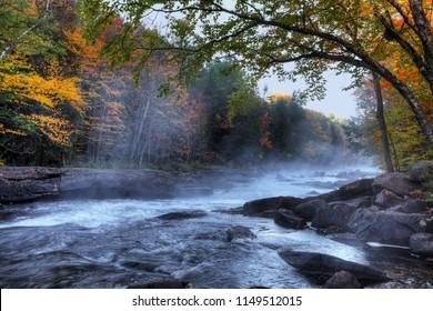 An Algonquin river rapids in beautiful fall colors