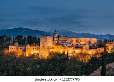 Alhambra by night with the Sierra Nevada in the background