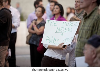ALHAMBRA, CA - AUGUST 11: A woman holds up a sign in support of a healthcare rally by U.S. Congressman Adam Schiff (D-CA) on August 11, 2009 in Alhambra.