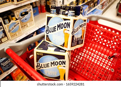 Alhambra, California/United States - 02/19/2020: A view of several cases of Blue Moon beer stacks inside a shopping cart, in a local grocery store.
