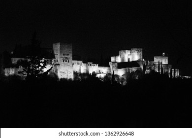 Alhambra de Granada at night (Andalusia, Spain). The Alhambra became the residence of royalty and of the court of Granada in the middle of the thirteenth century.
